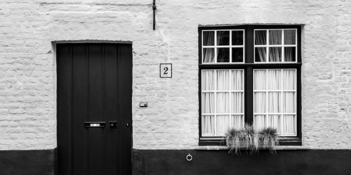 Black and white image of a front door | FAQs for Contractor Mortgages