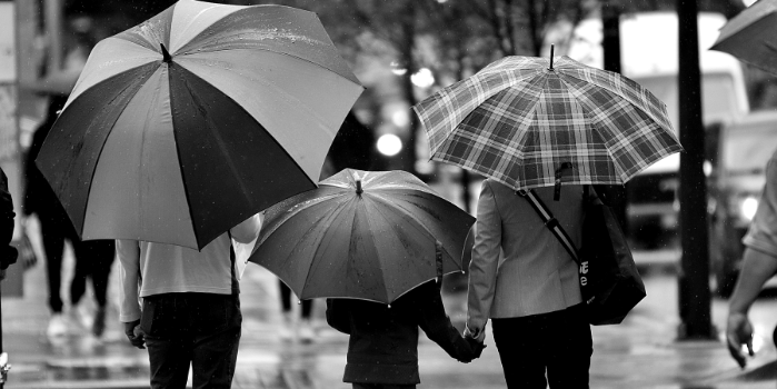 Family walking with umbrellas | Protecting yourself in light of IR35